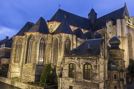 Saint-Michaels Church in Ghent in Belgium in the evening Stock Photo