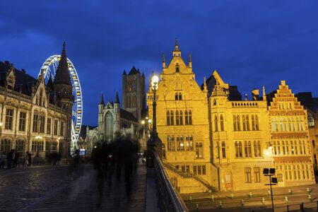 Historical centre of Ghent with old post office and Saint-Nicholas Church during Christmas