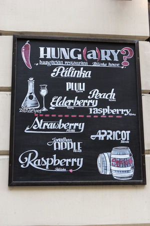 Restaurant sign on a building wall in Budapest, Hungary