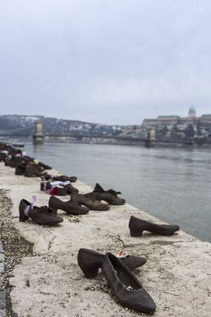 holocaust: Shoes on the Danube Promenade in Budapest - memorial to the victims of the Holocaust
