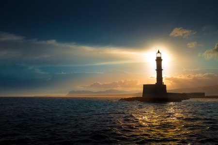 beacons: Lighthouse on sunset.