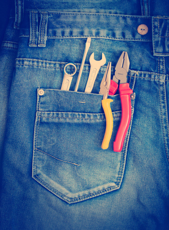 toolset: Several tools on a denim workers pocket. Stock Photo