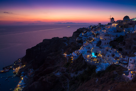 santorini greece: Lights of Oia village at night, Santorini, Greece.