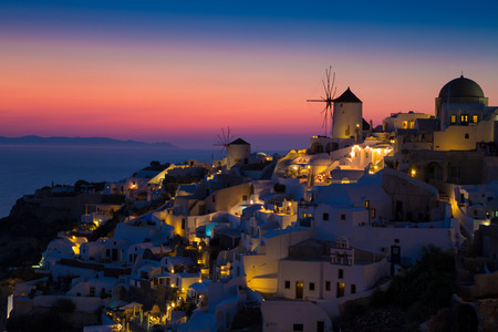 Lights of Oia village at night, Santorini, Greece.