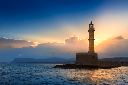 A beautiful night sky behind a shining lighthouse. Chania, Crete, Greece