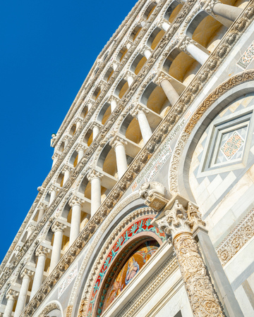 Day view of Pisa Cathedral with Leaning Tower of Pisa on Piazza dei Miracoli in Pisa, Italy