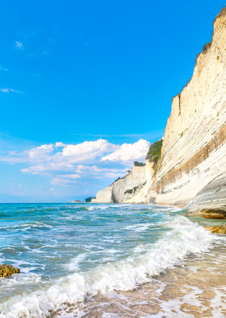 Logas Beach and amazing rocky cliff in Peroulades. Corfu. Greece