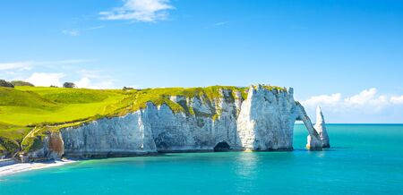 Picturesque panoramic landscape on the cliffs of Etretat. Natural amazing cliffs. Etretat, Normandy, France, La Manche or English Channel. Coast of the Pays de Caux area in sunny summer day. France