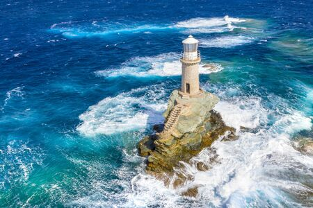 The beautiful Lighthouse Tourlitis of Chora in Andros island, Greece Banque d'images - 132642145