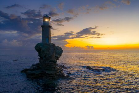 The beautiful Lighthouse Tourlitis of Chora in Andros island, Greece Banque d'images - 132642731