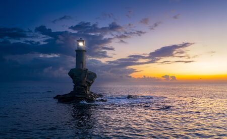 The beautiful Lighthouse Tourlitis of Chora in Andros island, Greece Banque d'images - 135003554