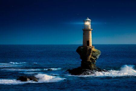 The beautiful Lighthouse Tourlitis of Chora at night. Andros island, Greece Stockfoto