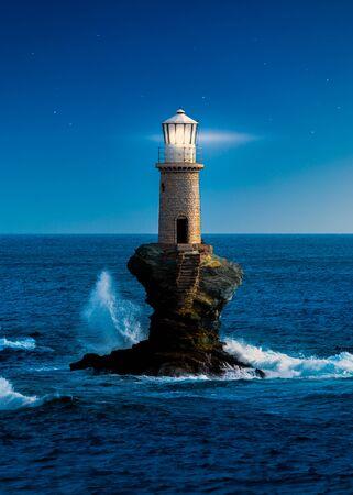 The beautiful Lighthouse Tourlitis of Chora at night. Andros island, Greece 免版税图像