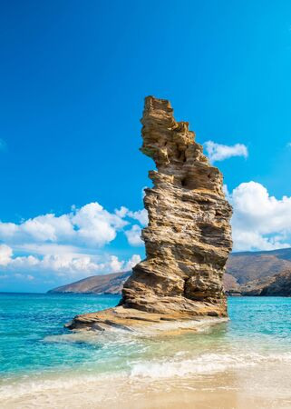 Photo of iconic beach of Grias Pidima near village of Korthi, with rare geological rock and turquoise clear waters, Andros, Cyclades, Greece