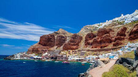 Old port of Oia village at Santorini island in aegean sea, Greece.