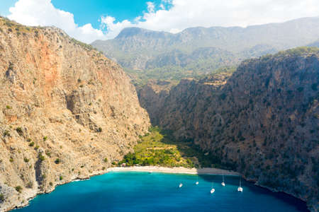 Aerial view over the clear beach and turquoise water of Butterfly Valley. Mugla Province, Turkey