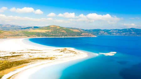 Aerial view over the clear beach and turquoise water of Salda lake. Burdur Province, Turkey