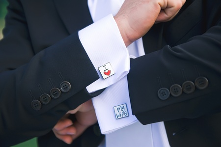 Groom showing cuff links