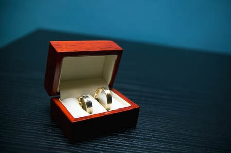 Wedding rings at the table photo