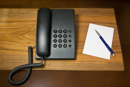 landline telephone and notebook Stock Photo - 12082103