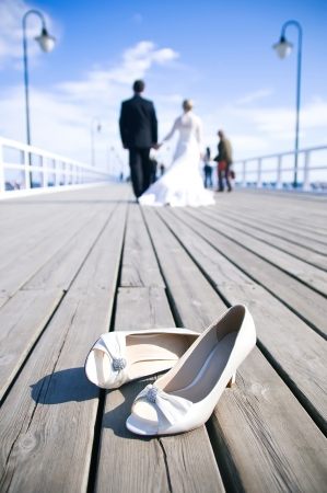 Wedding couple walking at the bridge  photo