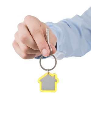 hand holding house key Stock Photo