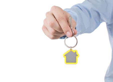 hand holding house key photo