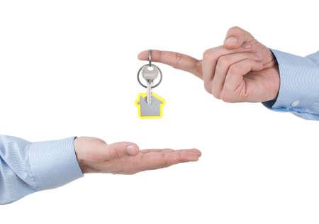 Elegant man Handing Over the House Keys