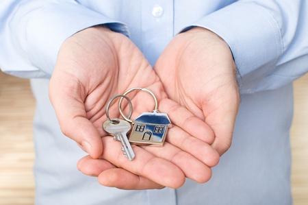 elegant man holding key  Shallow DOF, focus on key
