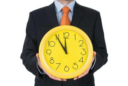Businessman hand holding the clock isolated on white background