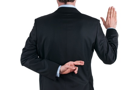 young businessman in suit telling a lie with the fingers crossed  on white background