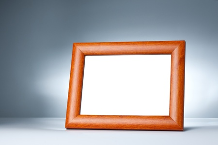 Blank wood picture frame on the table