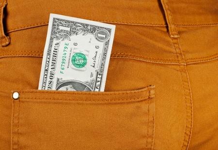 one dollar bill: money in jeans pocket,closeup