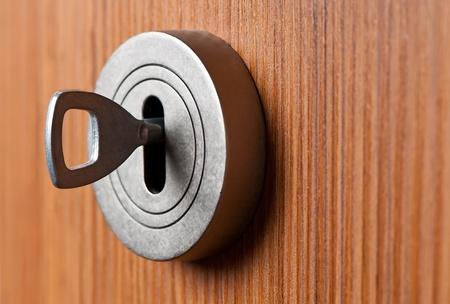 Silver Key in the brown door Stock Photo - 12872769