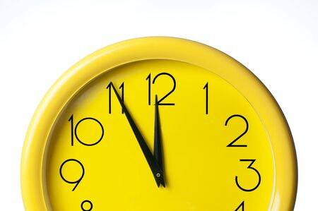 yellow clock on a white background Stock Photo - 12932985