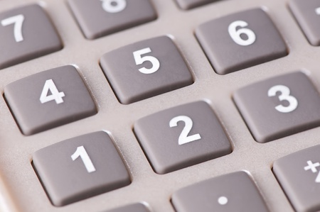 An isolated cutout of a calculator keypad photo