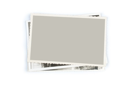 Stack of old photos on white background Stock Photo