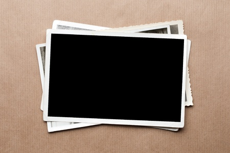 Stack of old photos on gray cardboard background Stock Photo - 13137931