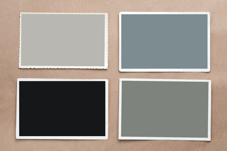 Set of four old, blank picture on gray cardboard background photo