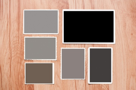 Set old, blank picture on table. picture on wooden background Stock Photo