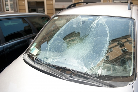 the broken windshield in car accident. insurance concept