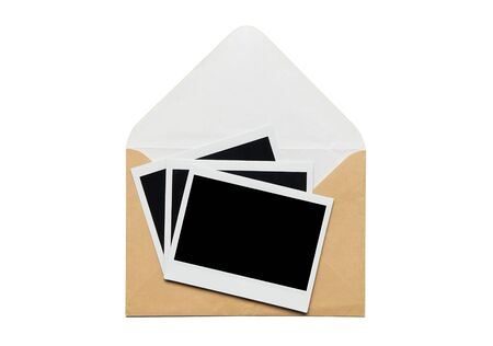 instant photo and open envelope. grey and old letter isolated on white photo