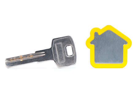 silver key and house on white background with clipping path  Stock Photo - 16831501