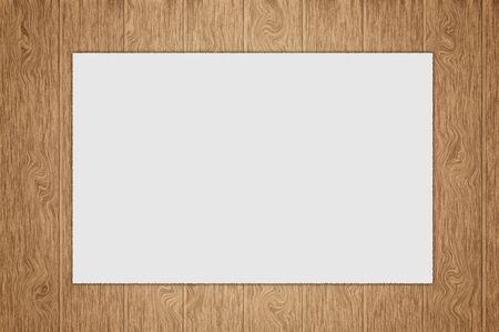 blank business card: sheet of blank paper isolated on wood  background with copy spac