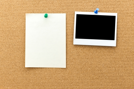 paper pin: Blank photo frame and paper sheets on the cork board with clipping path