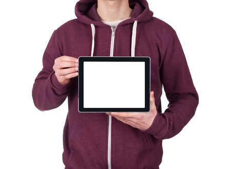 young man holding blank digital tablet. clipping path for the screen photo