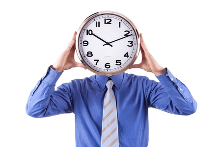 Young businessman with analog clock over his face  Deadline concept isolated on white background