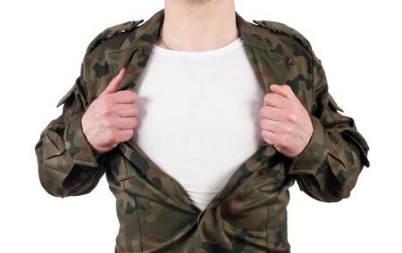 soldier acting like a super hero and opening his shirt off isolated on white background