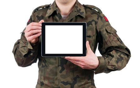 soldier holding blank digital tablet. clipping path for the screen