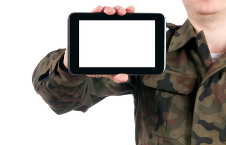 soldier holding blank digital tablet isolated on white background. clipping path for the screen Stock Photo